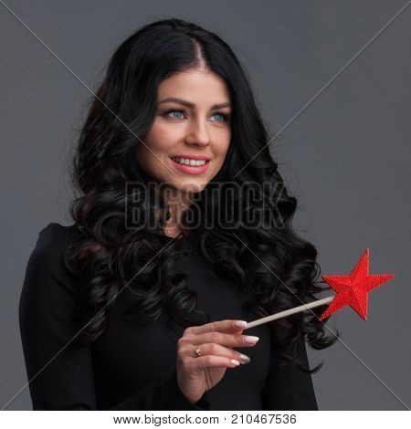 Woman with red star shaped magic wand