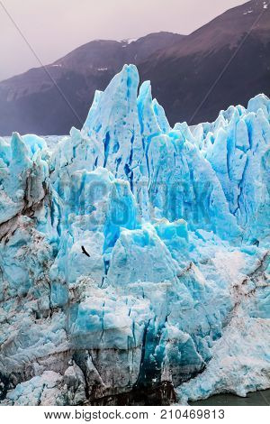 Patagonia. Unique lake and fantastic glacier Perito Moreno.  On the surface of the glacier formed Calgaspors -