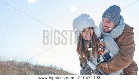 Happy couple in love in the nature in winter in the snow
