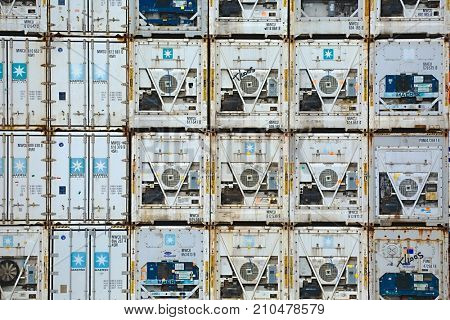 ROTTERDAM, THE NETHERLANDS - SEPTEMBER 25, 2016: Maersk containers stacked in a shipping terminal. Maersk is the largest container ship operator in the world since 1996.