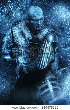 Halloween. Frozen snow covered zombie warrior in the armor of a medieval knight.