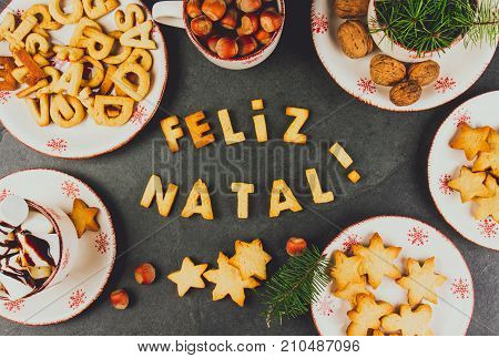 Feliz Natal Cookies. Words Merry Christmas En Portuguese With Baked Cookies, Christmas Decoration An
