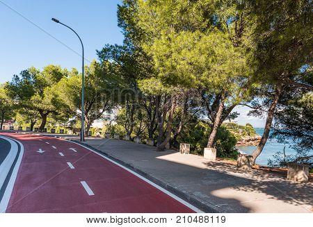 The Road Along The Coast Of The Costa Dorada In Miami Platja, Tarragona, Catalunya, Spain. Copy Spac