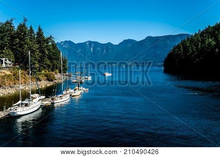 Sailboats at dock, in Snug Cove, Bowen Island on Howe Sound