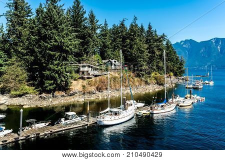 Sailboats and other ships at dock, Snug Cove, Bowen island on Howe Sound