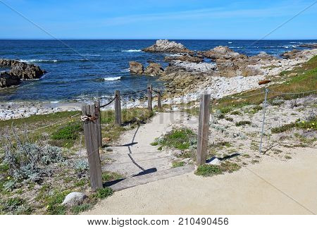 Stairs and walkway to the rocky beach at Asilomar State Beach on the Monterey Peninsula in Pacific Grove California