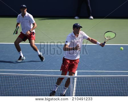 NEW YORK -SEPTEMBER 4, 2017: Grand Slam champions Mike and Bob Bryan of United states in action during US Open 2017 round 3 men's doubles match at Billie Jean King National Tennis Center in New York
