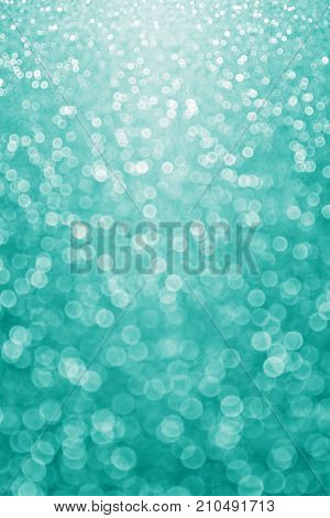 Abstract elegant teal green glitter sparkle confetti background for turquoise happy birthday party invite, aqua mint wedding banner pattern, sale poster texture or fancy Christmas card winter design