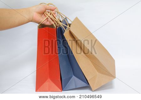 Colourful paper shopping bags isolated on white background. Concept of shopping,sale,gift,Christmas,consumerism.