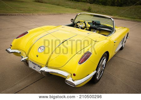 Westlake Texas - October 21 2017: A back side view of a yellow 1958 Corvette Chevrolet classic car.