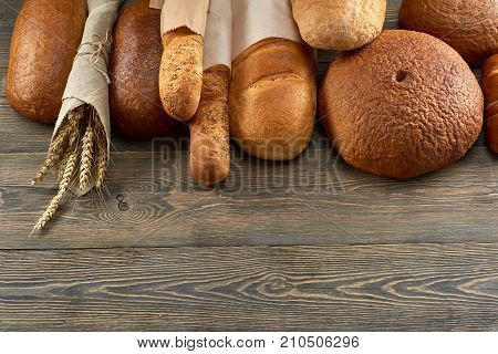 Top view shot of various bread on wooden background copyspace bakery shop store food groceries eating breakfast sandwich pastry baking dough concept.