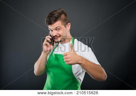 Portrait Supermarket Employer Holding Smartphone Showing Like