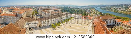 Coimbra panorama from top of bell clock tower. Coimbra city skyline and University courtyard on Mondego river. Coimbra in Central Portugal, is famous for its University, the oldest in Europe.