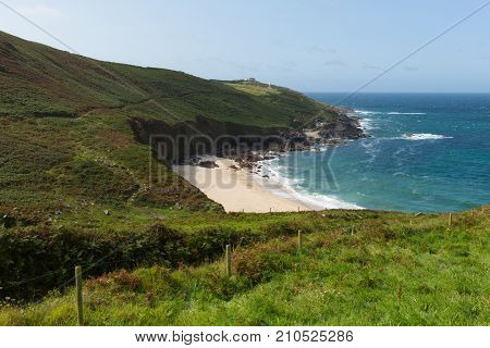 Portheras Cove Cornwall secluded beach on the Cornish coast South West of St Ives with blue sea and sky
