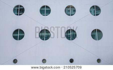 Twelve Portholes on Side of Cruise Ship