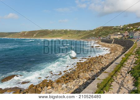 Sennen Cove seafront Cornwall with blue sea and sky and breaking waves, near Land`s End tourist attraction