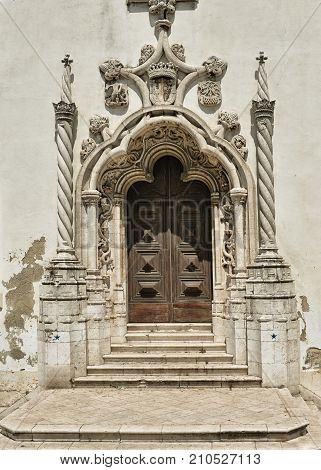 Old Beautiful door of antic building in center of Lisbon. Portuguese architecture detail background.
