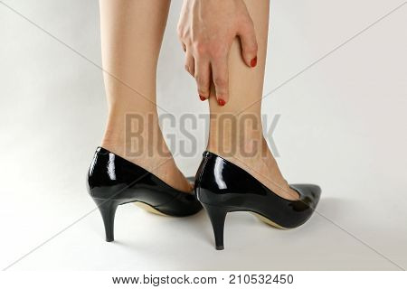The Girl Has A Blister On The Foot. Holding His Hands Behind His Leg. Closeup
