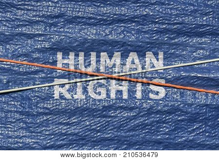Text Human Rights and rope over it written on blue background