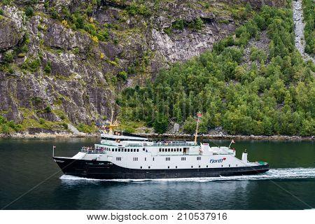 Geiranger Norway - September 5 2017: Geiranger is a 15-kilometre (9.3 mi) long branch off of the Sunnylvsfjorden which is a branch off of the Storfjorden (Great Fjord).