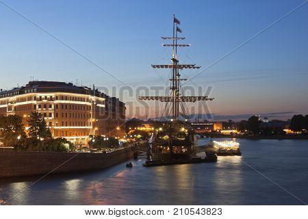 St. Petersburg, Russia - June 18, 2017: View of the Flying Dutchman sailboat on Mytninskaya Embankment in a summer night in St. Petersburg
