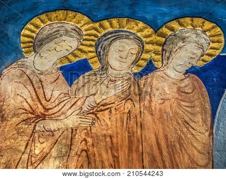 Three woman at the tomb of Jesus on Easter Sunday a romanesque wall-painting in Bjaresjo church Sweden November 6 2009