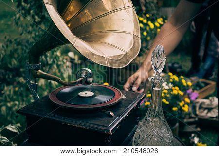 Turntable vinyl record player or vintage gramophone. Retro audio equipment for  vinyl disc, toned