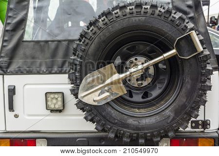 Small Shovel And Spare Wheel In An Off-road Vehicle.