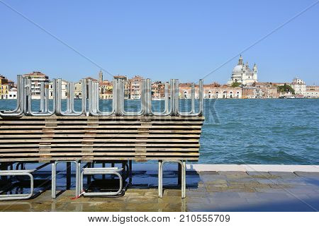 A pile of temporary walkways which are used during the regular acqua alta / high water flooding in Venice. Photo taken from the island of Giudecca looking towards Dorsoduro with the church of Santa Maria Della Salute (Saint Mary of Health) in the backgrou