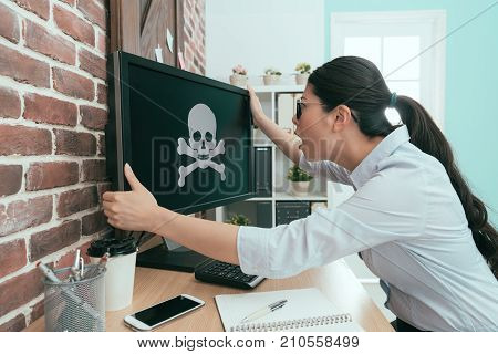 Female Office Worker Holding Computer Monitor