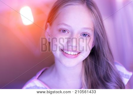 Happiness inside me. Beautiful alive blond girl beaming and looking straight into the cam and her eyes shinning