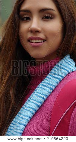 A Smiling Latina and Pretty Peruvian Woman