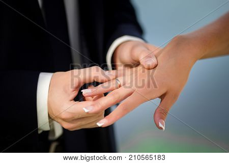 The Bridegroom Puts The Ring On The Bride