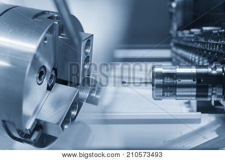 The abstract scene of CNC lathe and CMM measurement prob.CNC lathe machine or Turning machine with hi quality control concepts.Hi precision manufacturing process.