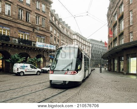 STRASBOURG FRANCE - SEP 25 2017: Tramway through empty Strasbourg downtown on an autumn morning near Galeries Lafayette