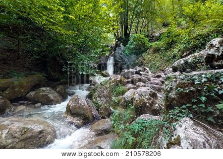 waterfall in the mountains in Montenegro in summer