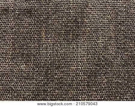 Dark woven sisal carpet texture and background