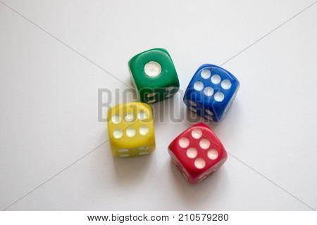 Multicoloured Dice Stacked red, green, yellow and green