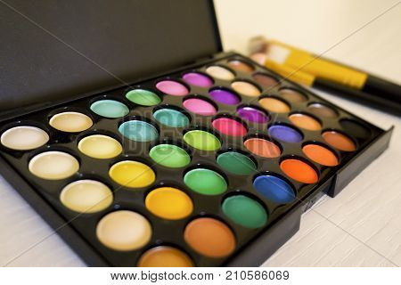 Make-up eyes hadow palette with brush. Palette colorful make-up closeup. Eye shadows set. Photo stock.