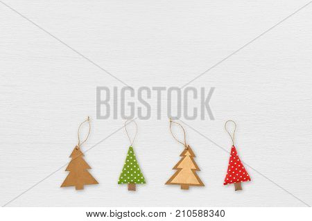Christmas tree decorations on white wooden table