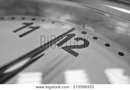 The clock struck noon in black white