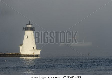 Palmer's Island Lighthouse glowing in sunlight penetrating fog