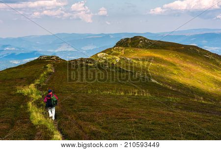 Tourist On A Foot Path Of Mountain Ridge