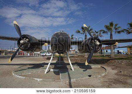 MEJILLONES, ANTOFAGASTA REGION, CHILE - SEPTEMBER 1, 2017: Historic aircraft, Douglas A 26 Invader, in the coastal city of Mejillones in the Antofagasta Region of Chile.