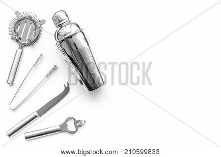Barman equipment. Shaker, strainer on white background top view.