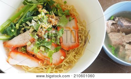 Egg noodle Cantonese recipes with BBQ pork and bone soup in set Photo close up full frame look testy.