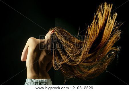 Woman With Stylish Long Hair And Naked Back.