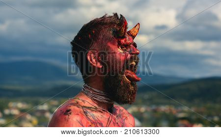 Halloween Demon Man With Beard Showing Tongue
