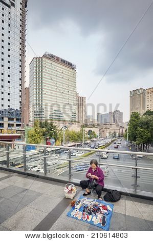 Chengdu, China - September 29, 2017: Street Vendor Selling Goods Laid Out On A Footbridge In Chengdu