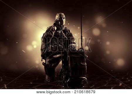 The Soldier Of The Special Unit In Military Uniform Sits Near The Satellite Communications Apparatus